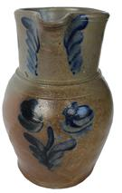 D153 Stoneware Pitcher with Cobalt Floral Decoration,Baltimore, MD, circa 1875, ovoid pitcher with narrow collar, the front decorated
