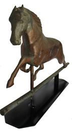 C492 This 19th C. copper swelled bodied running horse weathervane with rare cast iron head has lots of character.  The body  is all copper, condition, which includes dents,and plenty of wear. Come with stand for displaying  26 1/2� long x 14 1/2� tall 3 3/4� deep