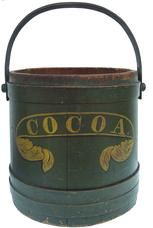 "W43  Outstanding 19th century  Pennsylvania firkin still retains it's original dark green  painted surface and stenciling the word  ""Cocoa"" in mustard paint.  The bands are held in place with rose head nails,  bent wood handle with wooden pegs  Completely original without repairs.  .Great for anyone who collects stencilled pantries and firkins.  it  measures 12-1/2"" tall"