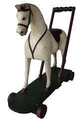 "C586 Beautiful  Antique Push Along Toy Horse.This 19th century antique horse is in  great, complete, original condition.The horse is very well carved and has the , original paint and decoration . It still has it original saddle, and bridel made for a child to push  circa 1880 Measurements are:  21"" long x 8"" deep x 19 1/2"" tall"
