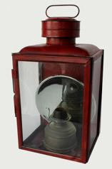 "(K778) DIETZ NO. 1 ""CLIMAX"" SHEET IRON STATION / SQUARE RAILROAD LANTERN, in old red paint , and with wire handle, three colorless glass panes including one with a hinged frame, cover marked ""DIETZ NO. 1STATION LAMP"" and reverse marked ""DIETZ / NO. 2 STATION LAMP / NEW YORK U.S.A."", reverse with two mounting holes, interior fitted with a silvered reflector and a removable circular-form font. Fitted with a No. 2 slip burner First quarter 20th century. 17 3/4"" H to top of cover, 8 5/8"" x 10 1/4""."