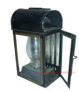 K180 This is a wonderful Oil Lantern, with what appears to be the original black and gold paint, possibly a Carriage lantern. The oil burning pot is separate and sits inside the enclosed lantern.  There is glass on 3 of sides, with tin in the back, a bracket on the back of the Lantern is for holding it in place
