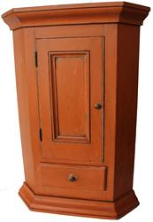 "C587 Mid 19th century Pennsylvania small hanging corner cupboard with a small panel door over a single drawers, with crown molding at the top and bottom, beautiful old salmon paint, all square head nail construction, takes a 14"" corner   x 27 3/4"" tall"