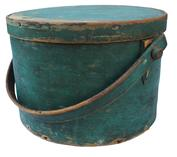 "C359  Early New England 19th century wooden bail handle Pantry Box, with the original windsor green dry paint, tacked lap joint, bent wood swing handle with wood peg Measurements are 11"" diameter x 8"" tall"