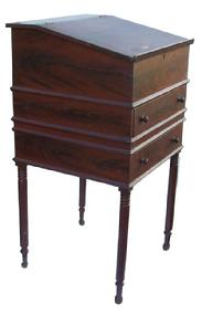 X34 Early 19th century Pennsylvania Ca. 1810 1830 paint decorated School Master�s Desk, with slant lid, over two full size drawers, resting on very gracefully turned legs , the Desk is decorated with red and black paint feather graining.