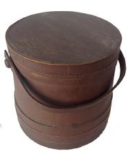 V339    New England red Covered Wooden Firkin, tongue and groove softwood staved sides, tapered lap joint wood bands, bent wood handle with wood peg attachments,