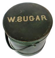 "B412 New England original dry green painted  Wooden Firkin, with W. Sugar on top,  tongue and groove softwood staved sides, tapered lap joint wood bands, bent wood handle with wood peg attachments, Measurements are:12""high. x 12""dia."