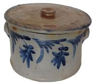 "A17   Philadelphia, PA, circa 1865, Cobalt-Decorated Stoneware Cake Crock with Lid, Remmey , crock with heavily-tooled shoulder and ribbed lug handles, decorated with brushed cobalt tulips on the front and back. Paired with a fitting Remmey lid also decorated. There is a few hair line cracks in the crock, with chips to the lid 19th c.,  9"" h., 13 3/4"" w"