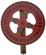 "Y112 Early 20th century  wonderful carnival gaming wheel is a nice piece of vintage Americana. The color is a deep red with green and gold  and blue details and large hand painted numbers in black. 24"" diameter"