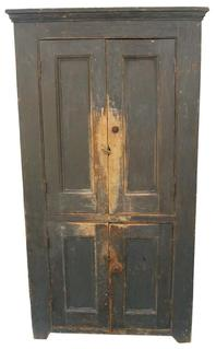 W205 19th century Pennslyvania four  door storage cupboard, original gray paint, all mortised and pegged construction,with molded panel doors,  with applied molding,cut out foot, the wood is white pine