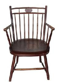 "B585  ""BIRDCAGE"" WINDSOR ARMCHAIR. Early 19th century, mixed woods. Bamboo-turned, with a medallion crest and the original paint"