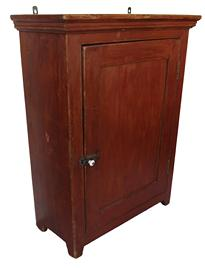 "C214Mid 19th century New England original red painted Hanging Cupboard, single panel door full mortised with a beaded edge around door, square head nail construction, small applied molding 23 3/4"" wide x 11"" deep x 21 3/4"" tall"