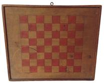 This 19th century New England  original painted checkers game board ( Dated 1871)  is painted wood surface and is constructed from a single wide pine plank, with applied molding  The playing field is painted bittersweet red on natural background, the back of the board has a notched  out storage compartment for checkers.The board stands 15 inches in height and 13 inches in width x 1� thick
