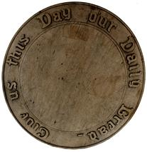 "C61 19th century   hand carved wooden bread board 9 1/2 inches in diameter. ""give us this day our daily bread"" is carved around the board"