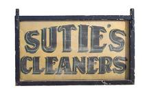 Suties Cleaners sign, black painted wooden frame with metal center. (c) 1890-1900 42 wide 24 1/2 tall 1 1/2 deep