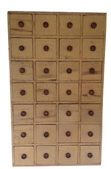 Z374 19th century New England Hanging Apothercary set of twenty eight drawers, all original nailed construction. This Apothecary was made to hanf so the wall would act as a drawer stop. Unusal size, form and shape, with the original paint. The drawer divider are mortised into the sidess