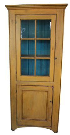"C582 Early 19th century Shenandoah Valley Virginia six window lites flat wall cupboard,in early yellow paint , very unusual small form, with a single glass door over a single paneled door below, wide single bead on corners, applied molding at the top, the doors are a full mortised and pegged. High arched cut out feet, Circa 1820""s Measurements are 32"" wide x 12"" deep x 73 3/4"" tall"