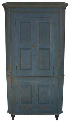 X443 Early 19th century  Pennsylvania original blue painted blind door Corner Cupboard, with a double raised panel doors at the top and a single raised panel in the bottom doors, resting on a gracefully turned feet, which is painted black.
