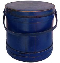 "Z465   Large  New England blue Covered Wooden Firkin, tongue and groove softwood staved sides, tapered lap joint wood bands, bent wood handle with wood peg attachments,  14 1/2""h. x 14-½""dia, top 15 1/4"" bottom (natural wear to surface"