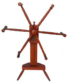 SB9 Pumpkin painted Yarn Winder, New England, 18th century, with wooden geared mechanism, on vase- and ring-turned post, chip-carved platform