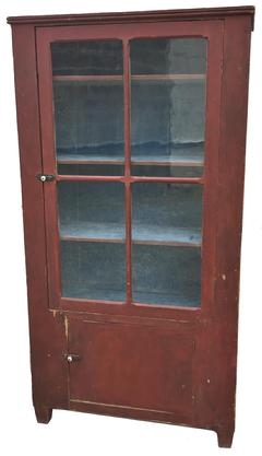 D171 19th century  Caroline County , Chimney Cupboard circa 1850   with glass door and over sized window lites, with the original red painted exterior and the original dry blue painted interior.Over a single board door with bread board ends. Applied beaded molding at the top, the wood is white pine. This Cupboard came out of an estate here in Caroline County Maryland