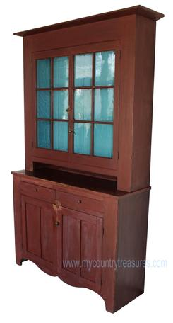 "JR2 Pennsylvania  two piece Stepback Cupboard, with original  dry red painted surface, 12 wavy glass window lights. The interior of cupboard has a warm blue painted interior. The hardware is original to the cupboard, doors have early brass, while the drawers have fine hand turned wooden knobs. measurements: 52 1/2"" wide  84"" tall 16 1/2"" deep"