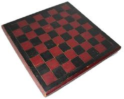 "B340 Late 19th century Game Board , with the original red and black paint, one board white pine construction, with a champfered edge, each block on the Game Board is deep scribed, to make each block stand out. carved on the back are the initials (C.C. H.)Measurements are: 14"" x14"""