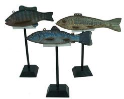 A group of three hand carved Fish Decoys, with stands