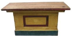 X543 19th century New Hampshire Store Counter, with the original yellow, red and blue paint , with a panel front, open back with two shelves, great overhang and height, to use as a work island.circa 1850