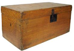 Y357 19th century paint decorated storage trunk ,  dovetailed construction, bottom is held on with  cut nails; with iron hinges and an external lock. Exterior retains the original mustard paint with sponge decoration; circa 1840