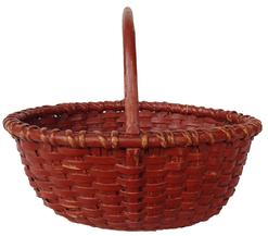 "A10819th century wonderful small New England Nantucket oval Basket with old red paint, very well made , with a wooden bottom very tightly woven with a single wrapped rim and a notched and steamed and bent handle , no break outstanding condition, beautiful color and wear. measurement are:9 1/2"" long x 7 1/2"" wide x 7 1/2"" tall"