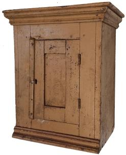 "A400  19th century Pennslyvania Hanging wall cabinet, with old mustard paint, single door  with in set panel, applied molding  to top and below door, it is pit sawed  one board construction , Measurements are: 18"" wide x 21 1/2"" tall x 11"" deep circa 1840"