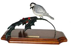 "C527 Bird on holly branch carved by Douglas Hanks Jr signed and dated 1978 measurements are 10"" long x 5"" wide"