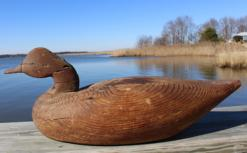 "Y139 Early wooden Goose Decoy with wonderful weather surface, attributed to a Long Island ,New York, Carver  , branded on the bottom, circa 1920's measures 23"" long x 9"" tall"