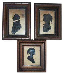 X442 Early 19th Century group of three Miniature Silhouette Portrait, Mother, Father and Daughter all framed in the original walnut frames, it looks like the silhouette is made of fabric, from a private collection Measurements are, Mother and Father 5 1/2� x 4 1/2� the Daughter is 5� x 4 1/2�