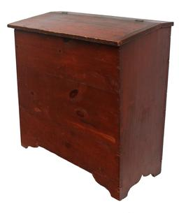 C474 19th century Storage Bin from Pennsylvania, with original red paint, lift lid, with a slight canted front, square head nail construction, with a nice high cut out foot. circa 1870