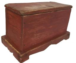 "D207 Early 19th century (1890 -1900) Eastern Shore diminutive Miniature Blanket Chest Eastern Shore Maryland, in the original red wash paint, applied cut out base on all four sides, one board square head nail construction, with snap hinges.Measurements are: 16"" wide x 9 1/2"" tall x 8 1/2"" deep"