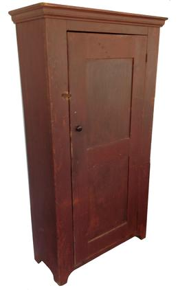 "M167 Lancaster Co Pa. storage Cupboard with the original dry red paint, dovetailed case and paneled door the interior of this Cupboard still retains traces of the original oyster white paint circa 1800 Measurements are:37"" wide case, 40"" molding top x 15"" deep x72"" tall"