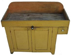 Z80 , 19th century, Pennsylvania York County   Drysink  with over hanging drawer, this is typical York co form ,with the original dry yellow paint , over two paneled doors, . circa 1860 all original