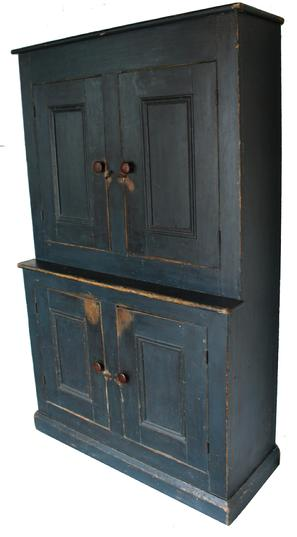 "EM2 19th century New England Stepback Cupboard in the original indigo blue paint, four panel door mortised and pegged, the interior of the cupboard is nice and clean, naturial surface, applied base with a chamfer edge,  circa 1820 Measurements are 18 1/4"" deep x 471/2"" wide x 77"" tall"