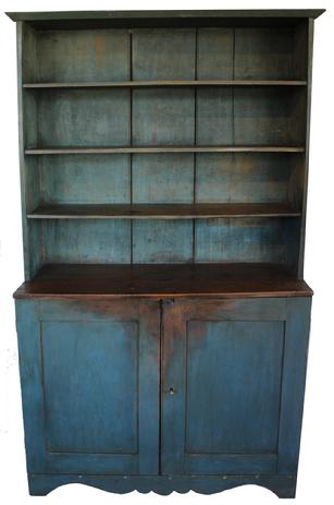 "C56219th century Pennslyvania open top Stepback Cupboard, early old blue paint over the original gray, open shelvies over two panel doors, the shelves are miortised into the sides the top of the cupboard is dovetailed slotted, the wide beaded back boards, with a beautiful scalloped apron. circa 1840 Measurements are 76 1/2"" tall x 47"" wide x 18 1/2"" deep"