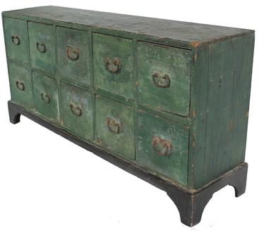 "W169 (LD) Early 19th century New England ten drawer Apothecary Chest early green paint over the original blue, wonderful blacksmith made heart shaped hardware, One board square head nail construction. The dividers between each drawer is beaded, the applied bracket base, was recently added to elevate the Apothecary to be ore functional in heigh. This Apothecary was found in CT. circa 1800 - 1820 Measurements are 53"" long x 26"" tall x 13"" deep"