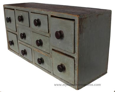 "D140 19th century Lancaster Pennslyvania 10 drawer apothecary chest, circa 1850 with the original gray painted case ,vey unusual drawer lay out, with two large drawers on each end, with six smaller drawers in the middle. The stretchers are mortised into the case, all original knobs square head ail construction great size. Measurements are: 25 1/2"" wide x 12"" tall x 8 1/2"" deep"
