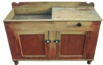 Y601 19th century outstanding Pennsylvania Drysink, with wonderful original red worn paint, the Drysink has two paneled doors with a single dovetailed drawer,very gracefully turned feet, with a scalloped back splash, all original