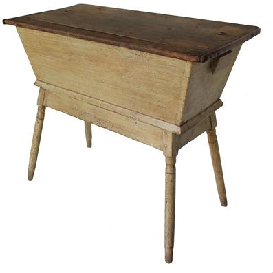 B135 19th century Western Maryland Dough Box on base, with removable top. early mustard paint over the original red, dovetailed case, resting on turned tapered legs, the lid is reinforced with  two dovetailed baton, circa 1830's