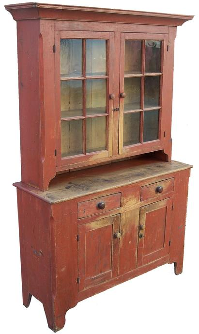 "Z82 Early 19th century Shendahora Valley Viginia  Two piece  Stepback Cupboard with the original dry red paint,the wood is white pine and yellow pine . Two-piece cupboard: the upper section with two six-pane glass doors, the lower section with two paneled doors , and two dovetailed drawers, all on bracket feet. Retains old red paint.  The interior of the cupboard has spoon rack and rail for plates circa 1820 77""h. 49""w. 17""d."