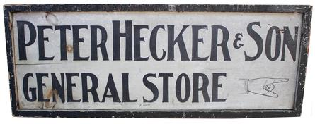 "C110 Late 19th century two sided  Trade sign Peter Hecker & Sons General Store, with white back  ground with black lettering  panited on board with applied molding, signed by the Artist ,  34 long x 13"" tall"