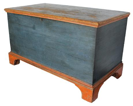 Im3  Early 19th century Lancaster County Pennsylvania Blanket Chest  circa 1820 in the original pumpkin and blue paint. dovetailed case, with applied molded bracket base,