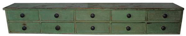 "B591  Early 19th century Country Store counter top Apothecary Cabinet (1820-1840)  with ten drawers, in the original beautiful apple green paint, one board construction, the drawers are square head nails, all drawer dividers are mortised into the case, all original knobs, this apothecary was made to set on a store counter agaist the wall, it never had a back the wall was used the drawer stop.  Measurements are: 65"" long x 10"" deep x 10"" tall"