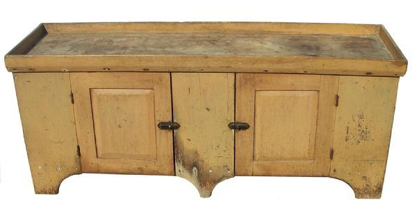 Y320  Mid 19th century Pennslyvania long Dry Sink very unusual form with a center foot , with old mustard paint, the wood is pine, two raised panel doors mortised and pegged, all square head nail construction,